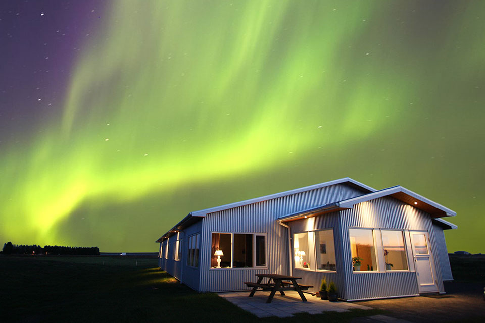 The northern lights dancing over Guesthouse Lambastadir